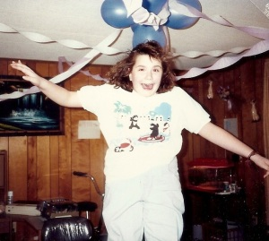 This was me at 13.  Rocking the acid washed jeans, a spiral perm, and a shirt with skateboarding cats. (?)