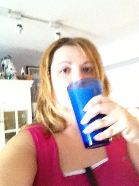 Drinking my morning smoothie, wearing my Fitbit and getting ready to work out.
