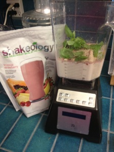 This was my Shakeology a week or so ago.  Tropical Strawberry + a whole lot a basil and a little bit of lemon.